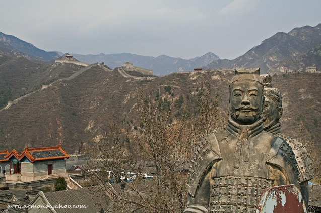Sculpture of Ancient China Soldiers and Great Wall in The Background